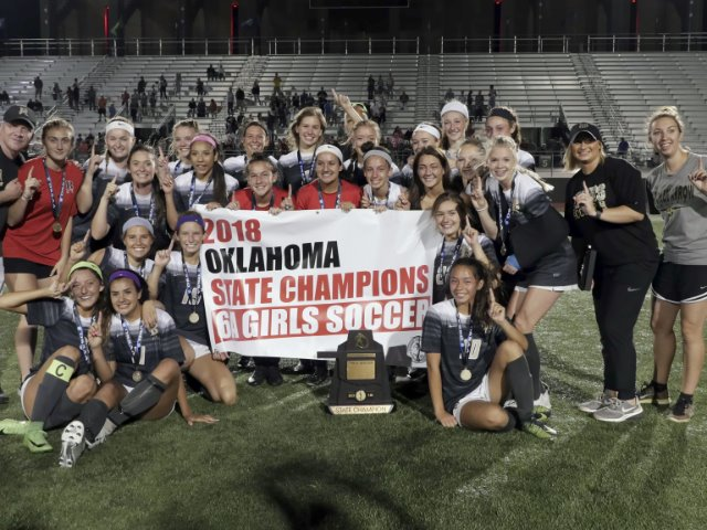 Lady Tigers cap perfect season with state title