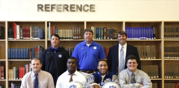 FOOTBALL PLAYERS INK SCHOLARSHIP