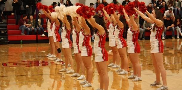 Varsity cheer pumping the crowd up on senior night