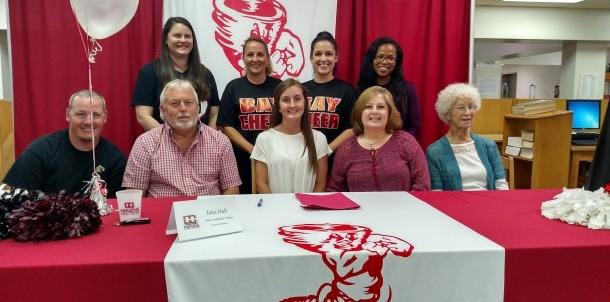 Julia Hall signs cheerleading scholarship