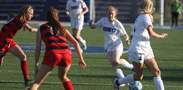Bryant girls challenge league leaders but fall 2-1