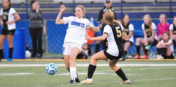 Bryant girls take league leaders to shootout but come up short