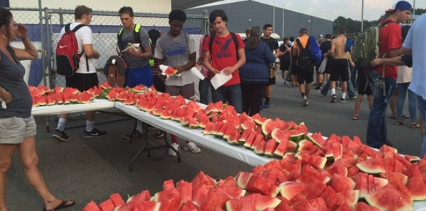 Boosters provide post-practice watermelon for Hornets