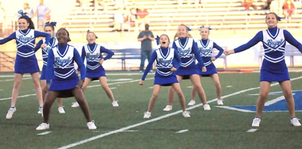 Seventh-grade dance, cheer perform at halftime