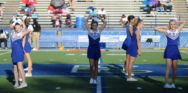 Seventh grade dance, cheer perform at halftime