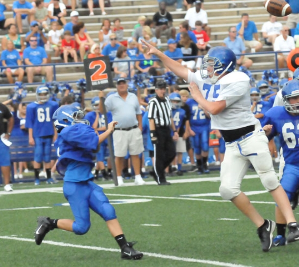 Late touchdown pass carries Blue past White in seventh grade battle