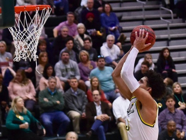 Boys basketball starts area play with 2 wins
