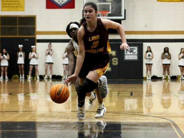 Image for article titled Lady Wolves roll Lady Trojans on road