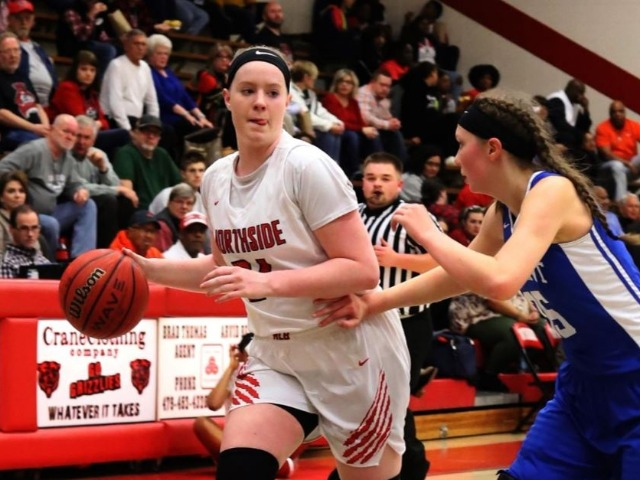 NHS girls improve to 20-0 after holding off Bryant