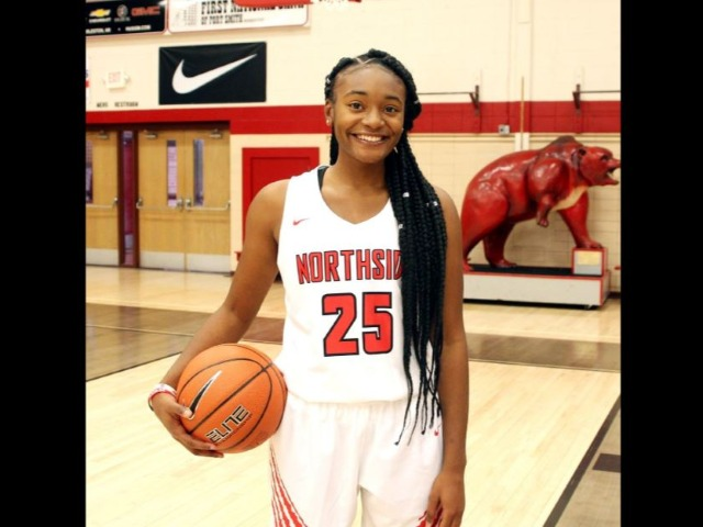 Two NHS Lady Bears sign with colleges