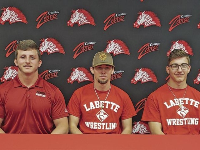Claremore wrestling trio signs letters of intent