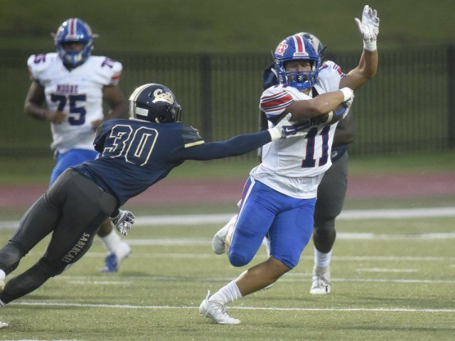 Moore meets Mustang with a different attitude after last season's controversy