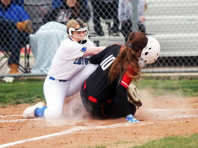 Lady Roos outlast Lady Trojans on the road