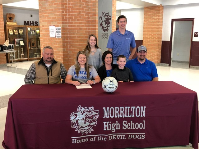 MaKayla Jones signing letter to play College Soccer for Central Baptist College