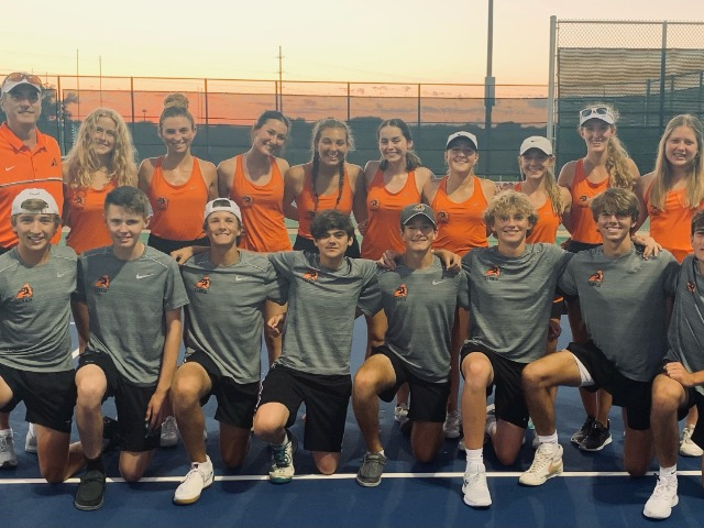 AHS Tennis collides with Arlington Heights in Playoff Action
