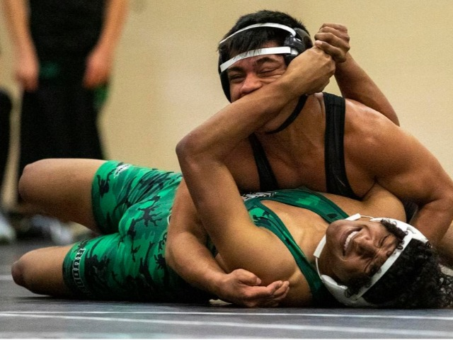 A&M Consolidated boys wrestling team beats Rudder