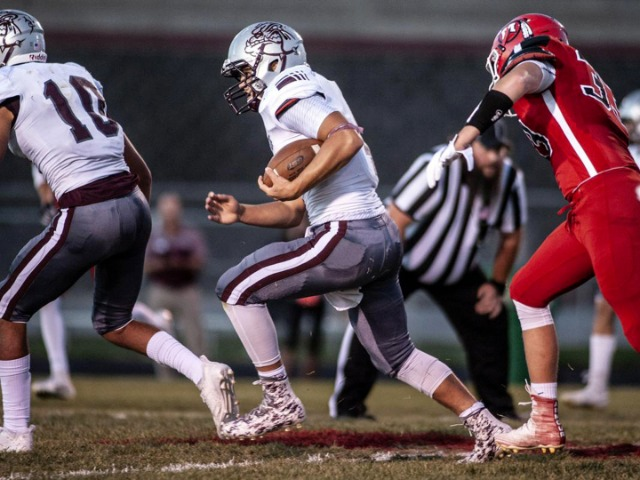 Simmons' late TD run lifts Indians past 'Dogs