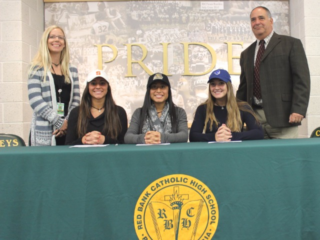 Taylor Lane, Allison Tomaino, and Gabrielle Ciancio signing on National Signing Day for softball