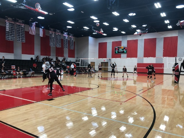 8th Volleyball plays in Home Opener