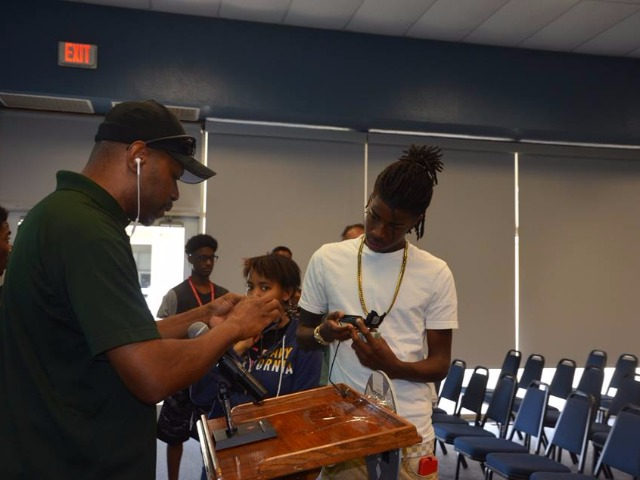 LRSD video production instructor, Roger Robinson, gives hands-on training to Metro students