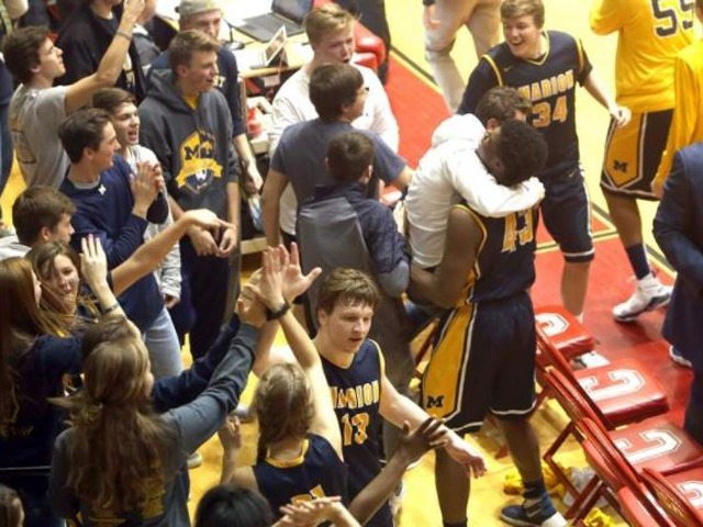 Marion clamps Columbia, advances at Sectional