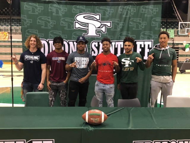 Football standouts sign college letters
