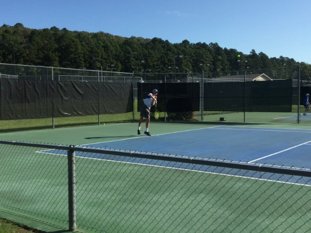 Armstrong in action at the 4A State Tennis Tournament at Burns Park