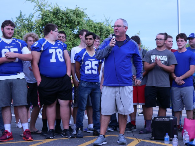 Coach Wells speaking at the Stone Bank Pep Rally