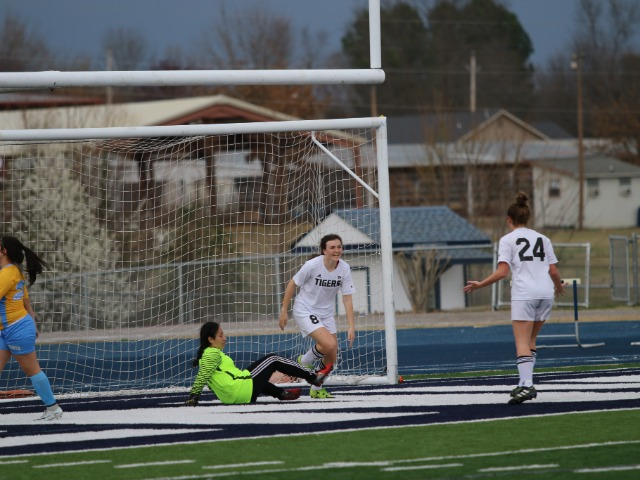Christa Davenport celebrates scoring against Putnam City West at the River Valley Cup in Greenwood, AR