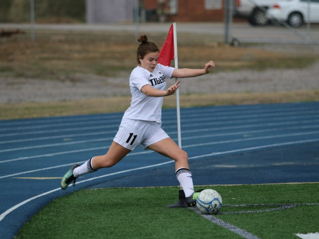 Andrea Kuegler taking a corner kick at the River Valley Cup in Greenwood, AR