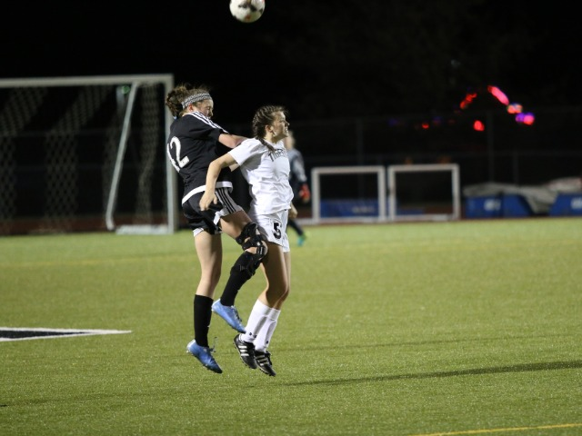 Anna Passmore battles with a Bishop Kelley defender(3/5/18)