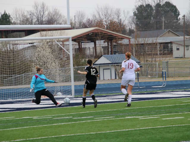 Natalie Smith scoring against Holland Hall at the River Valley Cup in Greenwood, AR