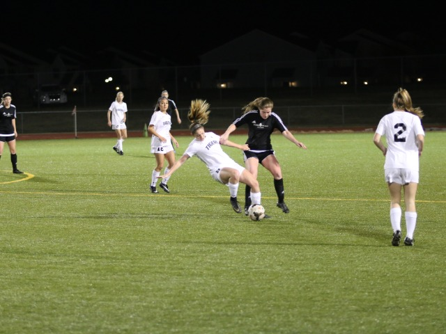 Madi Howard fighting for the ball against Bishop Kelley(3/5/18)