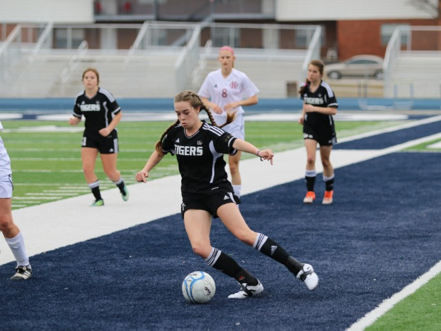 Lexi Matlock crossing the ball against Holland Hall at the River Valley Cup in Greenwood, AR