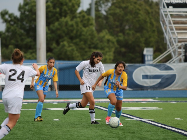 Stevie Law driving the midfield against Putnam City West at the River Valley Cup in Greenwood, AR