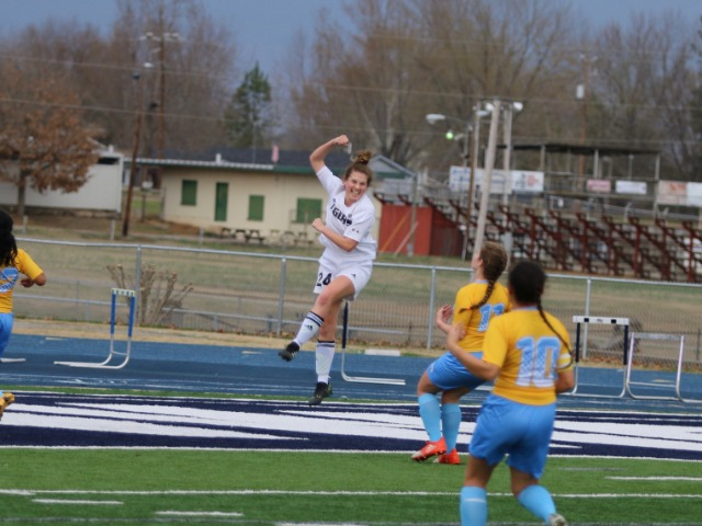 Sydney Wagner celebrates scoring against Putnam City West at the River Valley Cup in Greenwood, AR