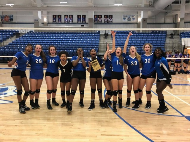 Conway Blue celebrates winning the Lady Cat Invitational