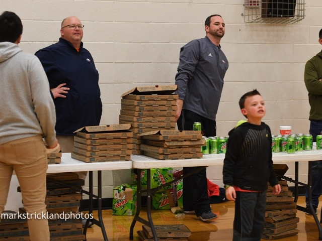 Serving Pizza to the student section for Basketball Game 1.25.19