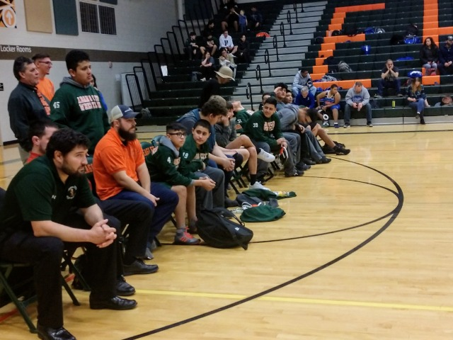 Coaches and Teammates engaged in the match