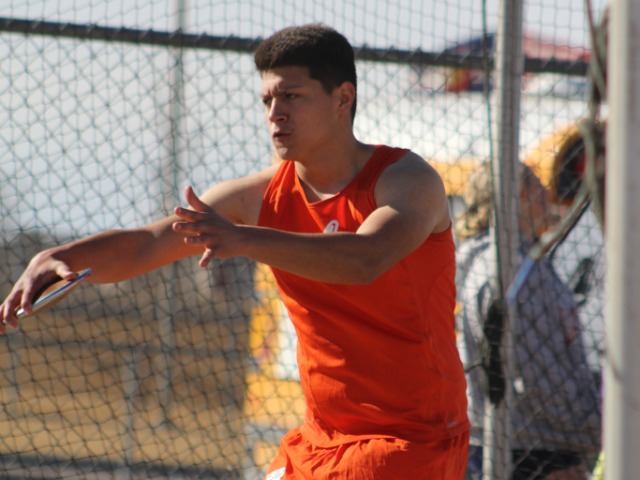 Adams City's Francisco Rodriguez prepares to let the discus set sail during the Thornton Early Bird Invitational March 10 at Mountain Range High School. He improved 5 feet in his first two throws of the competition and finished 20th. His best throw was 76 feet 2 ½ inches. The top girls finisher for the Eagles was Amia Medina.  She was seventh in the 100-meter dash in a time of 14.02 seconds.  Carlos Barrera took second in both the 200-meter dash (22.89) and the 400-meter run (53.16). Johnathon Meyers was fourth in the 400-meters (55.79) and fifth in the 800-meters with a time of 2:21.08.  Photo by Steve Smith