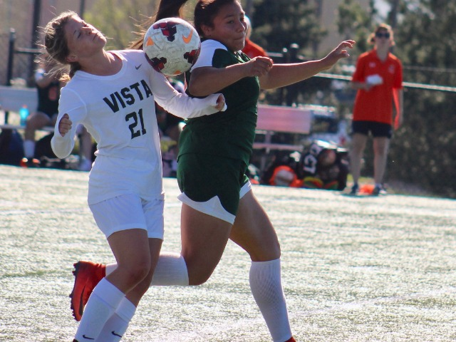The loose ball seems to fall between Adams City's Litzi DeLaRosa and Mountain Vista's Ashleigh Willette during the first round of the state 5A girls soccer playoffs May 8 in Highlands Ranch