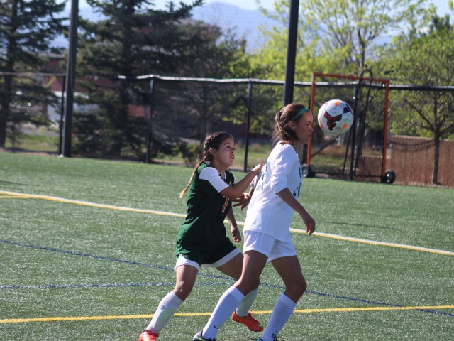 dams City's Brenedi Sierra keeps close tabs on the ball and on Mountain Vista's Shantell Hafner.