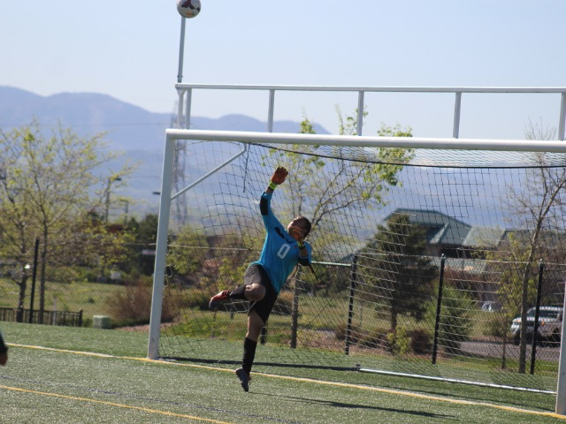 Adams City's goalkeeper, Suseth Zamora, tries to reach this lofting shot