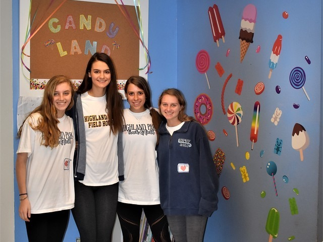 2019 Community Service Project - Voice of Hope - Sophomore Emma Means, Juniors AC McCormick, Kate Lampe, and Lizzie Means showing off their classroom wall.