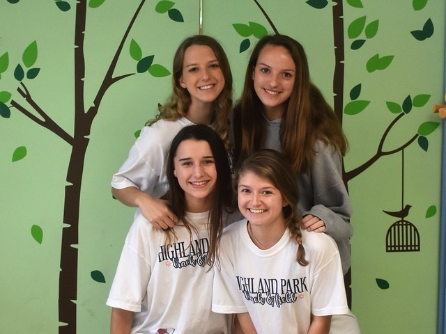2019 Community Service Project - Voice of Hope - Junior Captain Olivia Conner, Sophomore Caroline Morton, Freshman Hadley Bornemann, and Sophomore Adelaide Aiken showing off their doors.