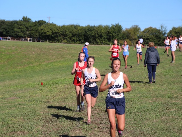 2018 District 11-5A Meet - Senior Abbie Meinecke and Freshman Bethany Spence