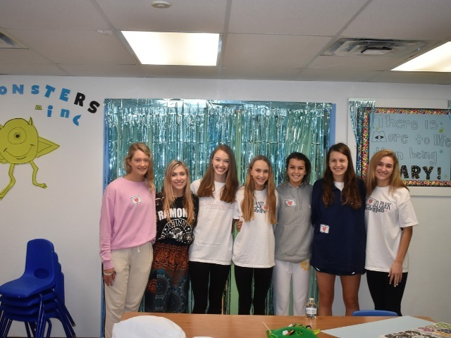 2019 Community Service Project - Voice of Hope - Junior Sara Carlisle, Senior Sidney Stamm, Sophomores Claire Cochran and Meredith Sims, Freshman Katelyn Turco, Senior Sarah Dalton, and Katherine Rossley showing off their decorated classroom.