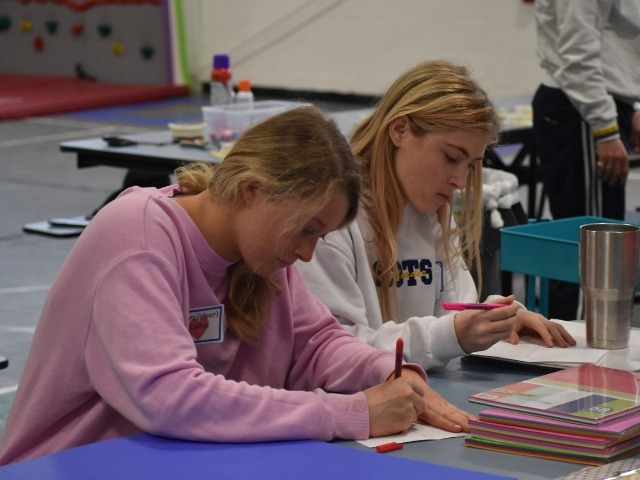 2019 Community Service Project - Voice of Hope - Junior Sara Carlisle and Senior Sidney Stamm writing cards.