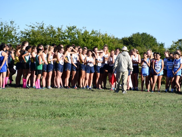 2018 District 11-5A Meet - JV listening to Doc on the starting line