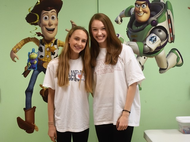 2019 Community Service Project - Voice of Hope - Sophomores Meredith Sims and Claire Cochran showing off their doors.